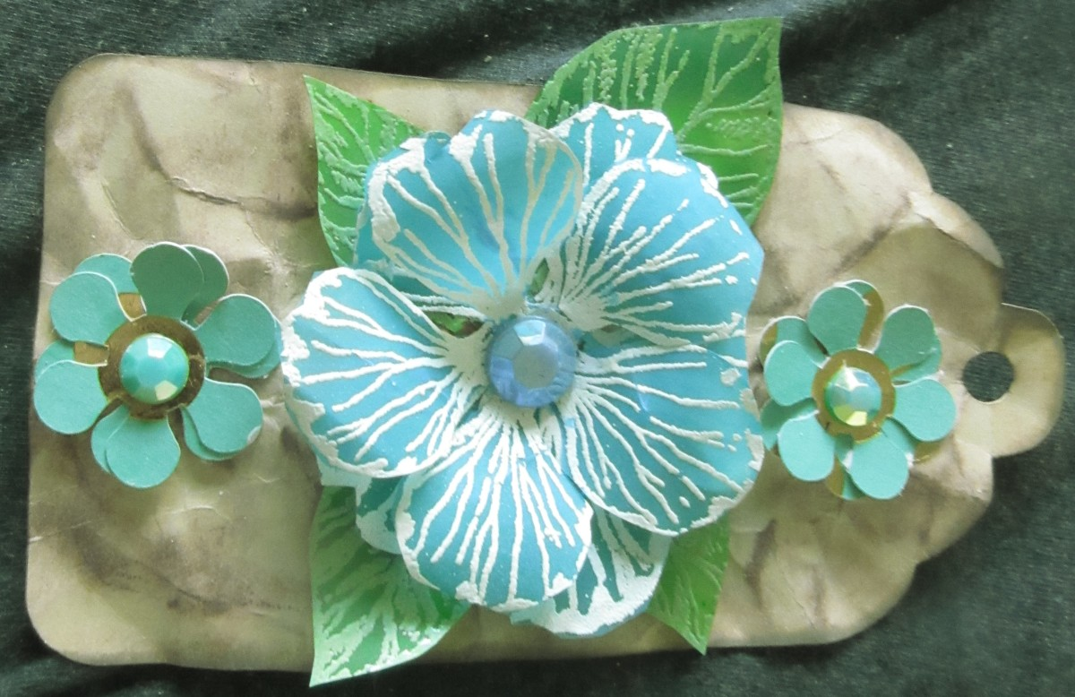 Vellum can be used to make wonderful flowers. It can be started as a white or neutral, then be colored with any color you would like, once it has been die cut.