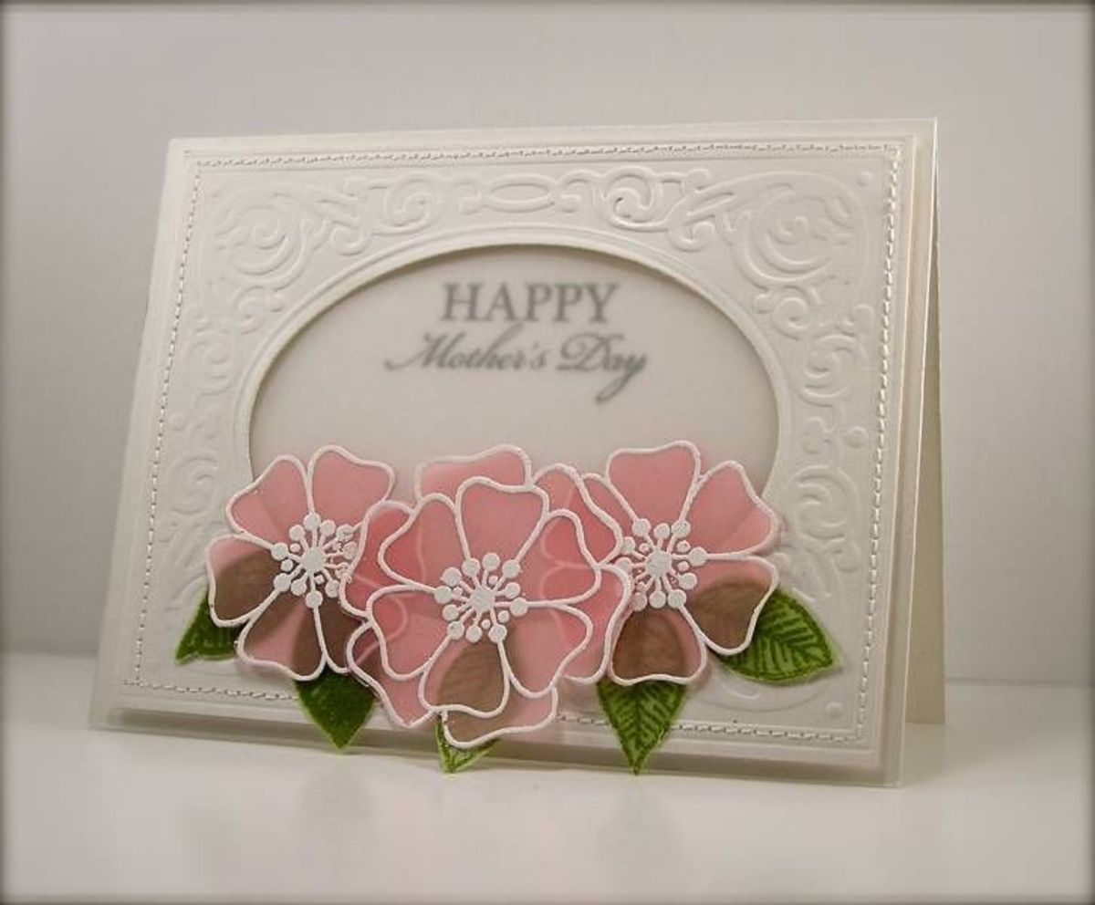Using vellum to emboss and die cut adds a certain elegance to any project