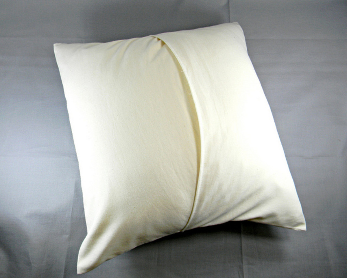 Make a drop cloth pillow cover with an overlap closure -- no need for buttons or a zipper.