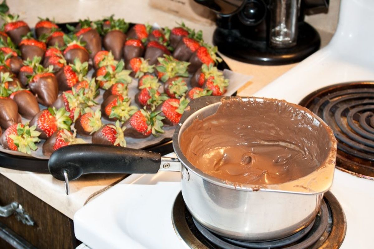A simple double boiler is all you need to dip chocolate strawberries. Bring water to a boil, then decrease heat to low.
