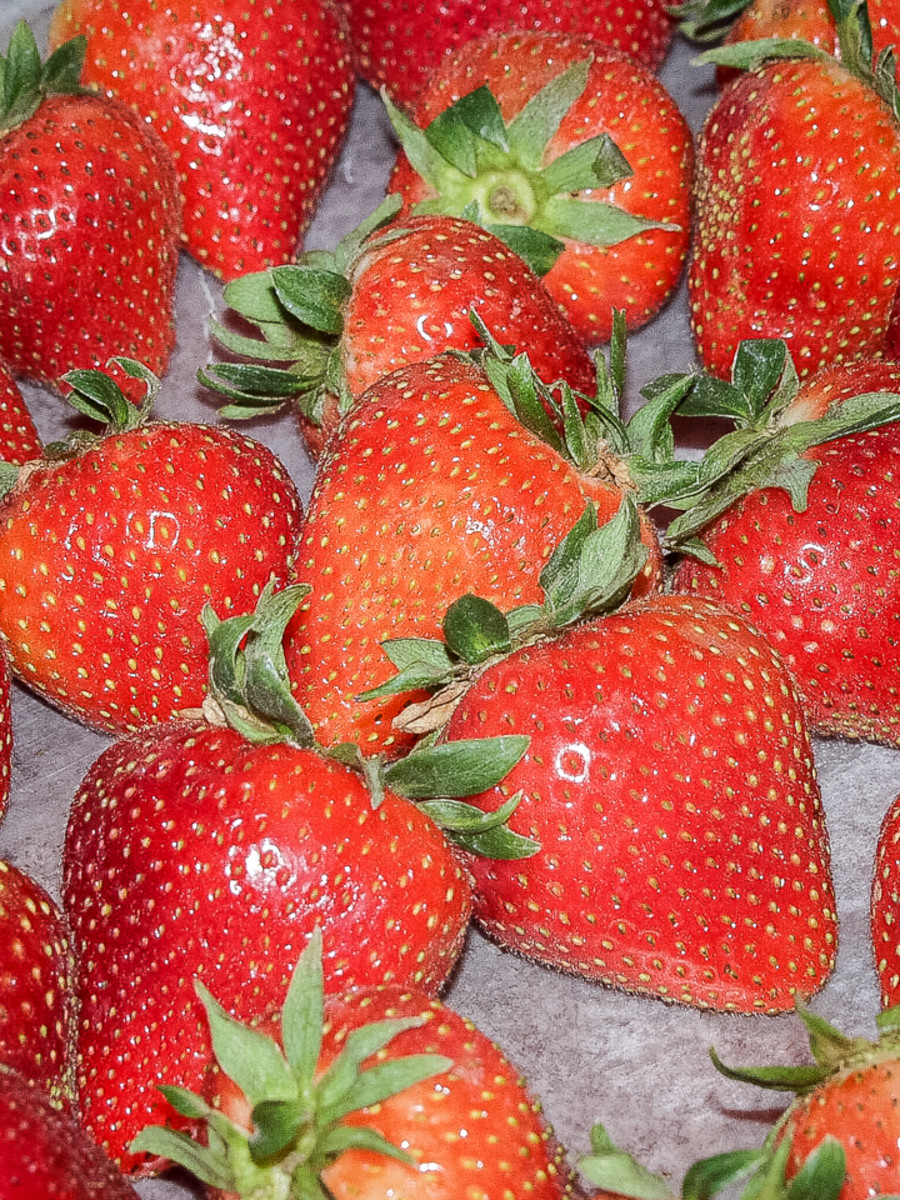 Freshly washed and dried strawberries, waiting to be dipped.