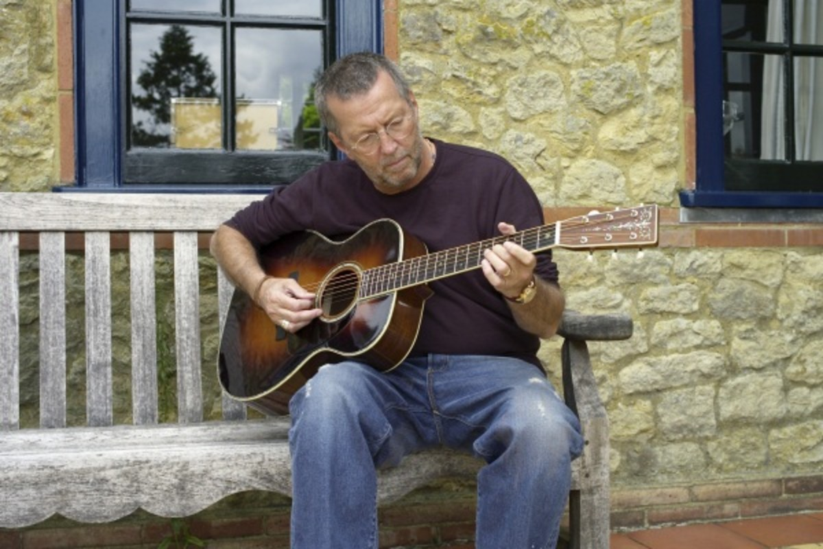 Eric Clapton with a Martin 000-28EC with Sunburst Finish.