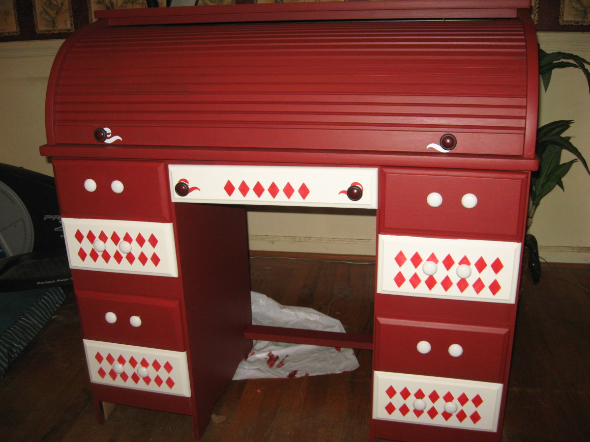 red roll-top desk with white accents