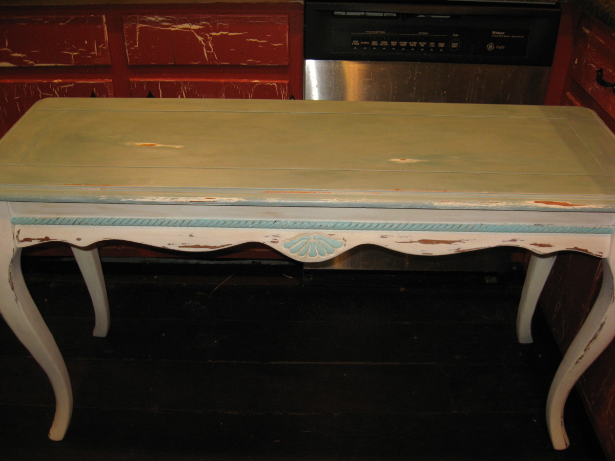 I painted the trim on this table a different color.