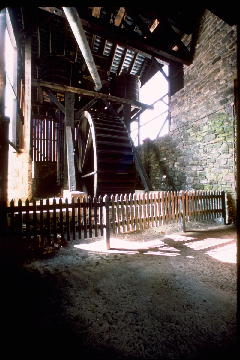 A huge water wheel supplied power to the industrial bellows blowing blasts into the furnace at Hopewell.