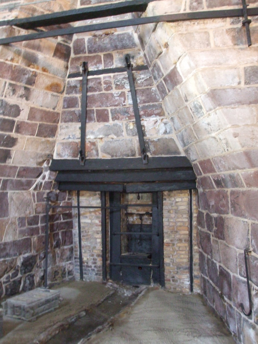 A view of the bottom of the Cornwall furnace with a trough in the sand floor for the molten iron.