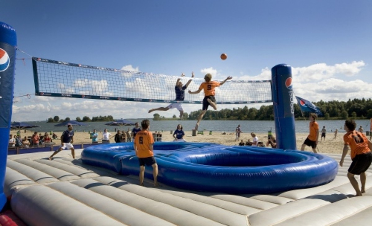 Bossaball Is Volleyball Played On An Inflatable Court To Latin Music