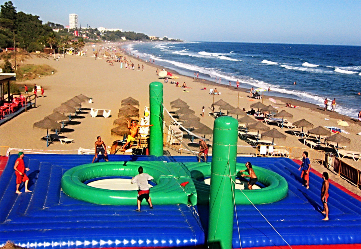 Bossaball Being Played On A Beach