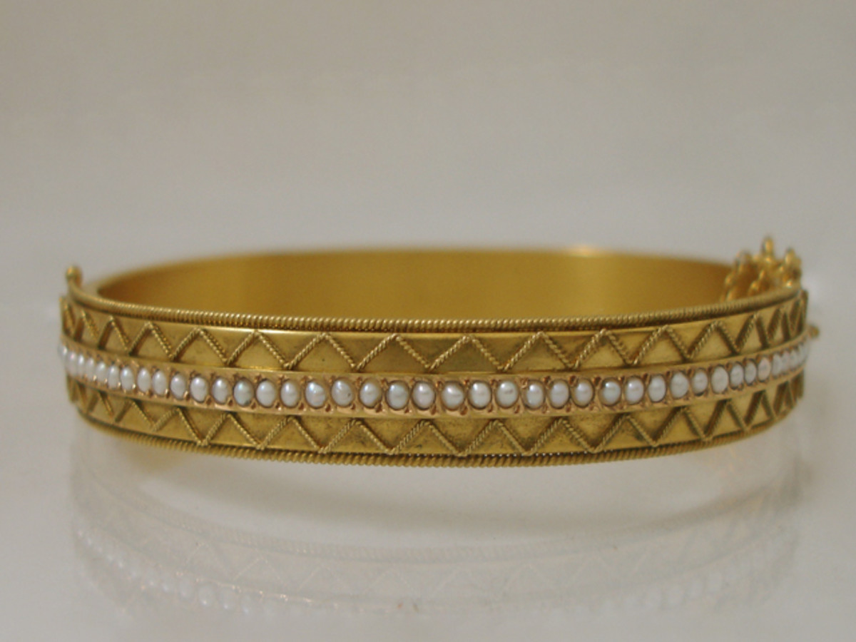 bangle bracelet has fifty one seed pearls in 15 ct gold by Castellani