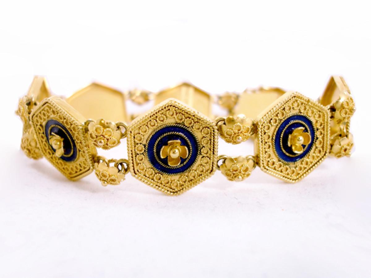 15 kt yellow gold flexible Castellani bracelet featuring fantastic milgraining and wonderful rich blue enameling.