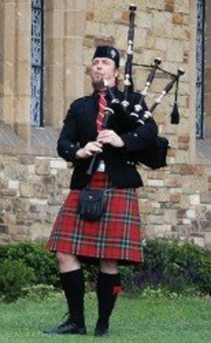 Bagpipers play throughout Galicia and wear the Scottish kilt, part of their Celtic traditions.
