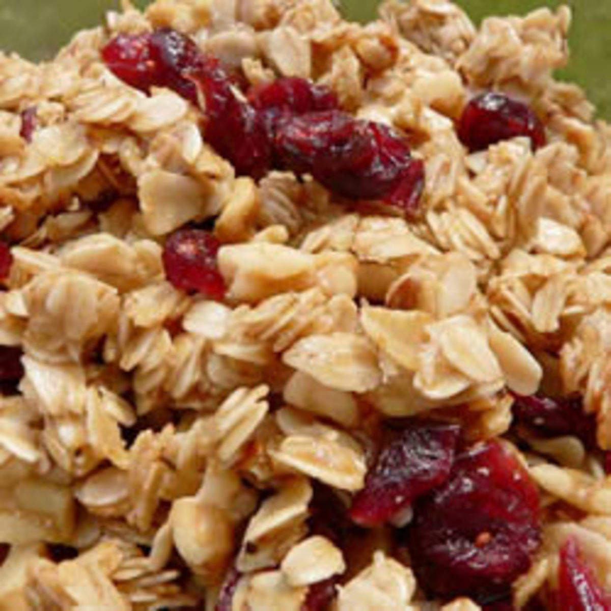 This delicious stovetop granola begins with toasting oats in olive oil and is sweetened with brown sugar, honey and dried cranberries.