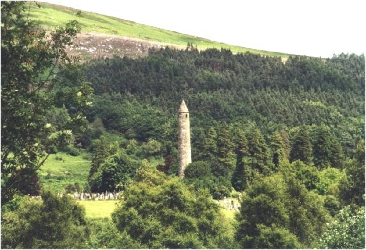 Round tower from Celtic Gaelic period and Irish landscape.