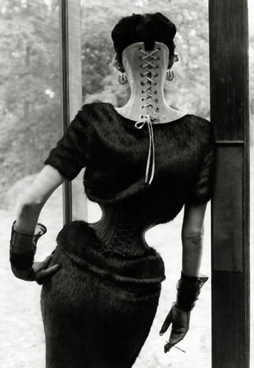 "Ethel Granger had the smallest waist on record,obtained through the strong urging of her husband to ""corset train"".Ethel wore the corset 24 hrs a day to shape her body.From there he moved on to piercing her for his own admiration."
