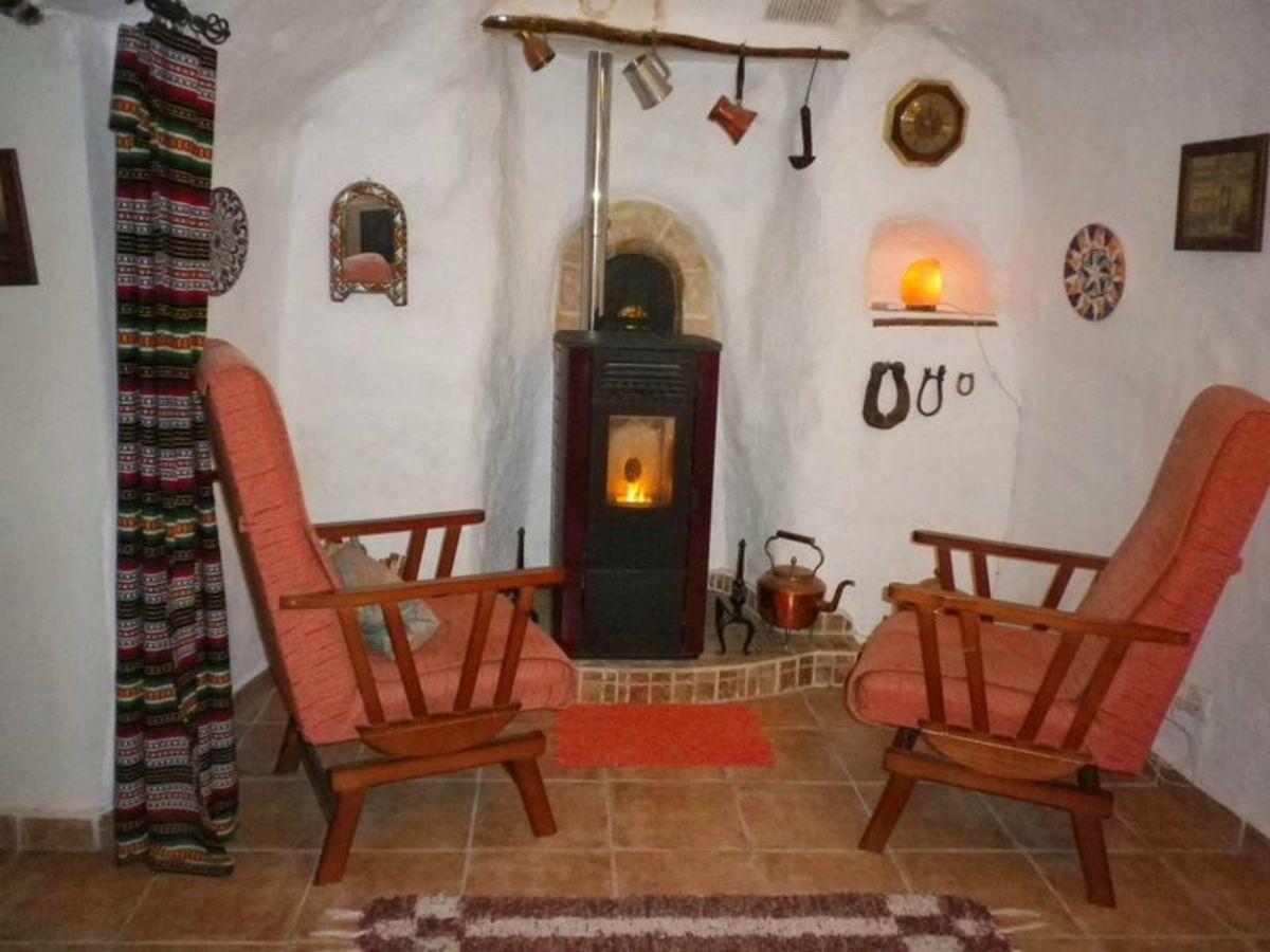 Modern wood pellet burning stove. (Note original bread oven door behind the stove.)