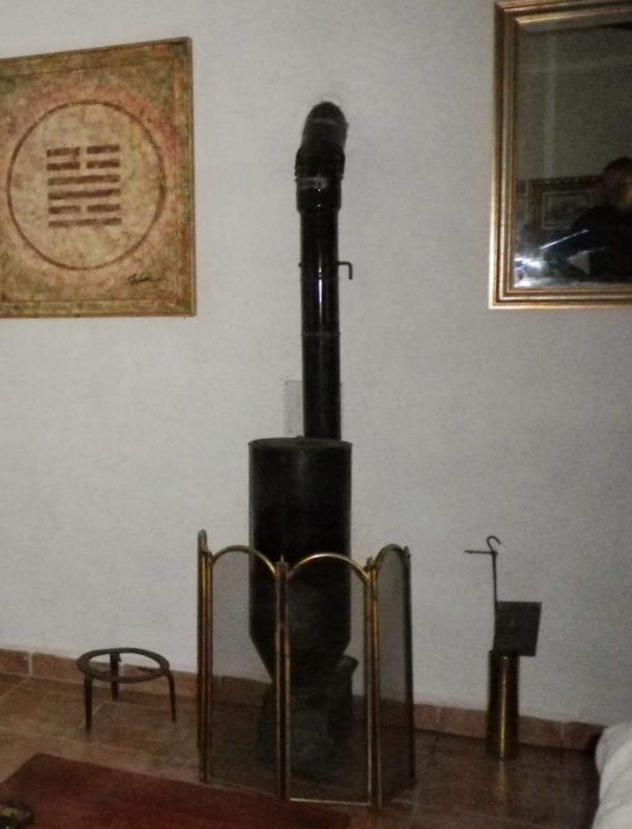 An almond burning stove.  Cheap to run with immense heat output.
