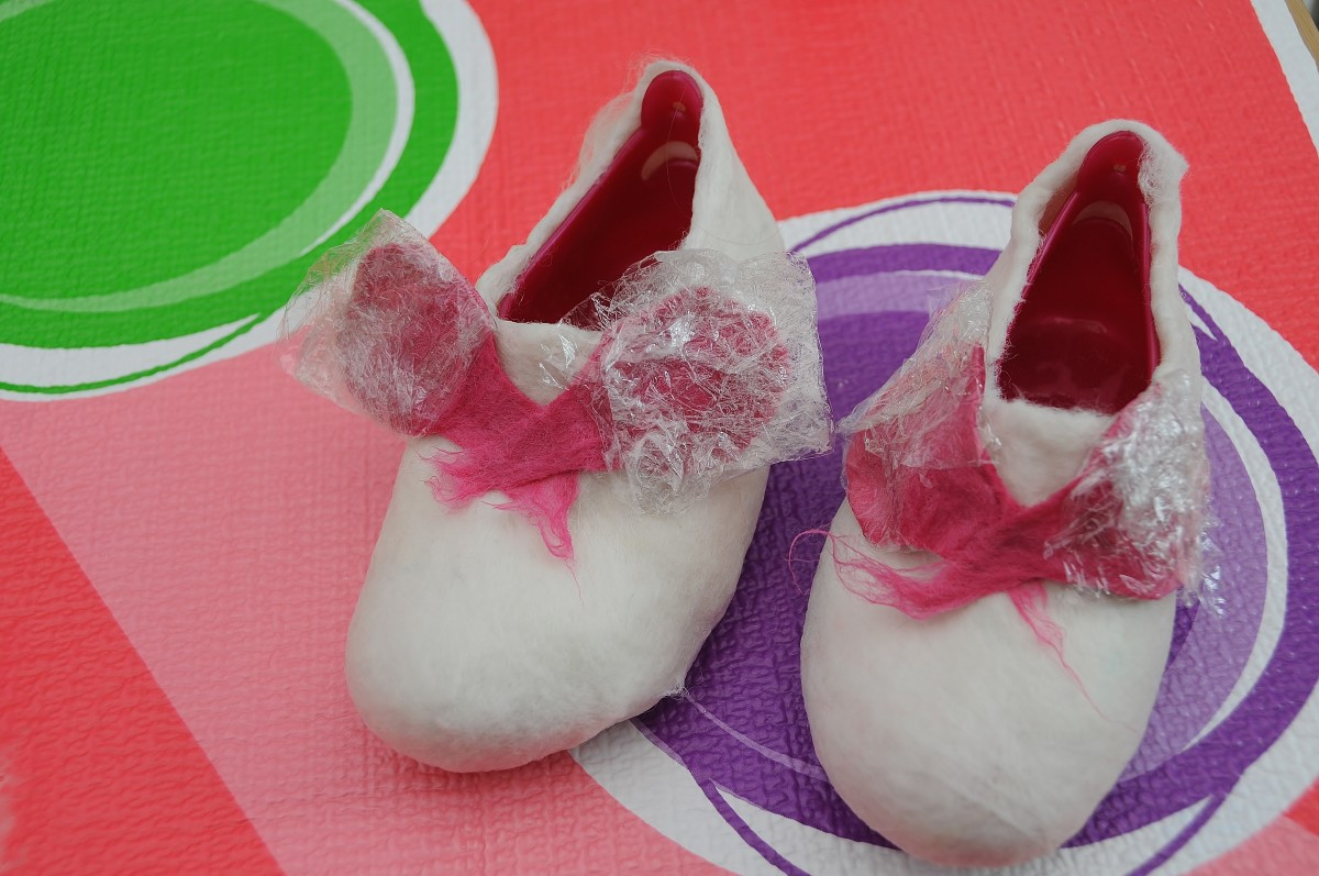 The  wrapped ears placed on the aqua shoes.
