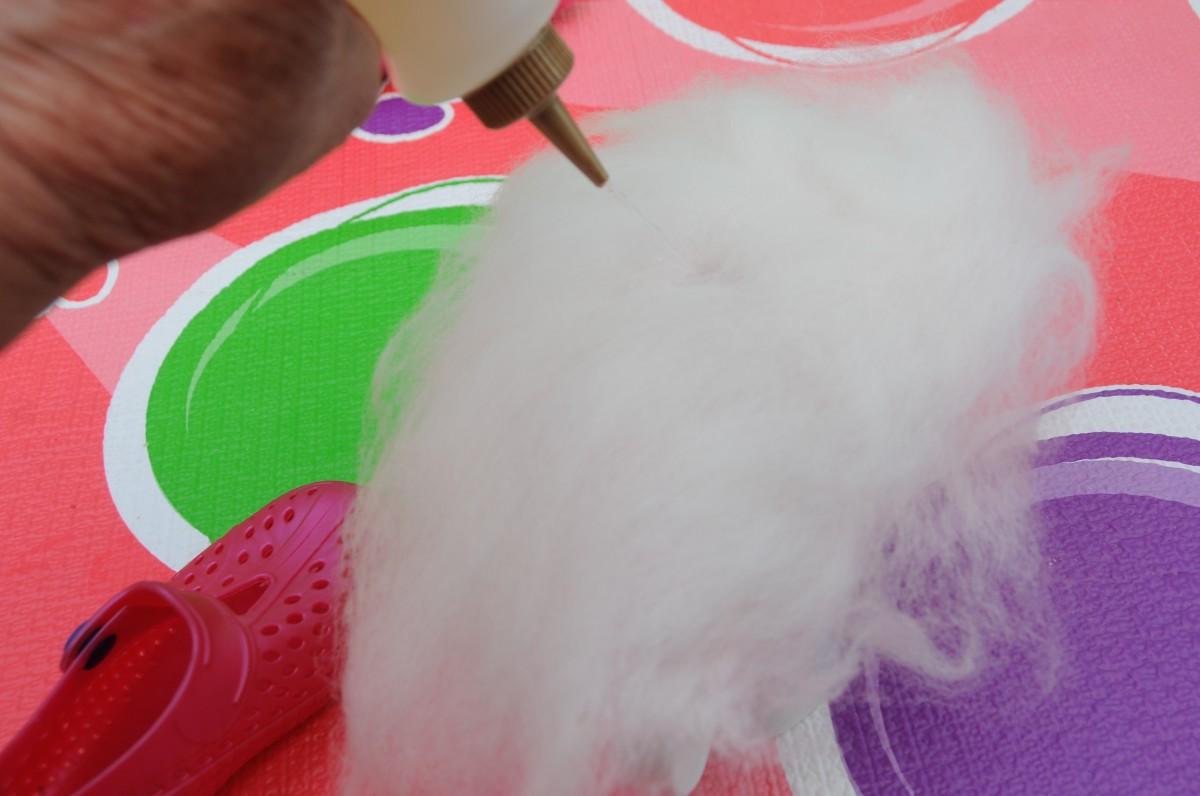 Wetting the wool fibers