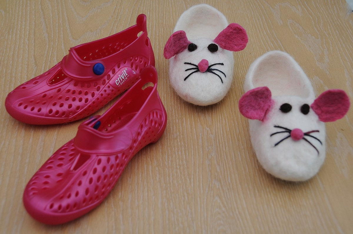 The almost finished slippers as compared to the aqua shoes