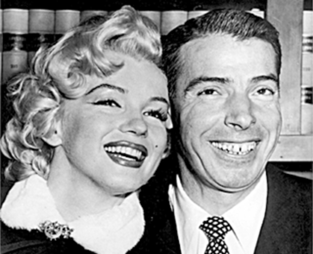 Marilyn Monroe and Joe DiMaggio on their wedding day (January 14th, 1954).