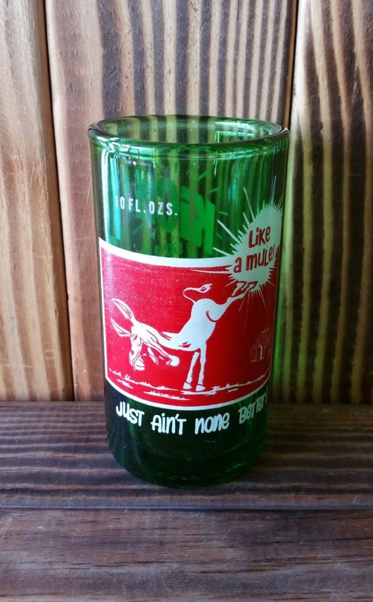 This vintage glass is made from an upcycled KICK soda bottle. Each glass is flame cut and polished to give you a smooth finished rim.