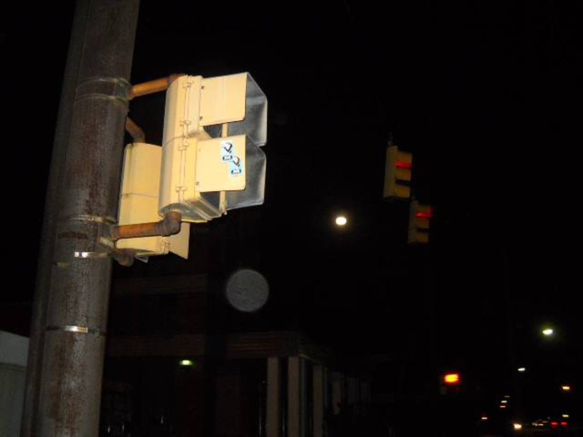 I tried to take a picture of the full moon while we crossed the street. Looks like an orb wanted to take a look as well.