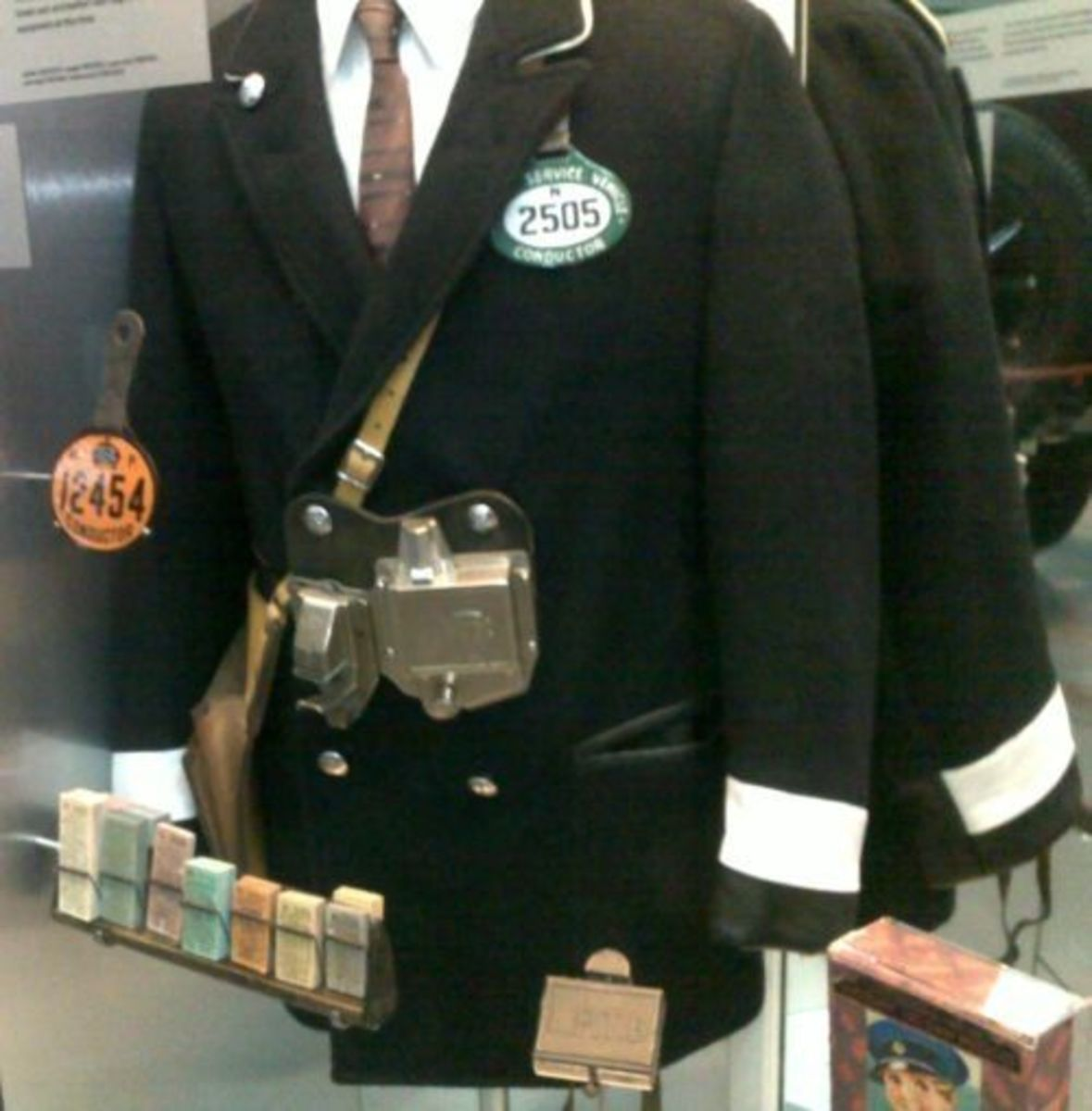 Bus Conductor Uniform with Ticket Machine and Range of Colored Tickets