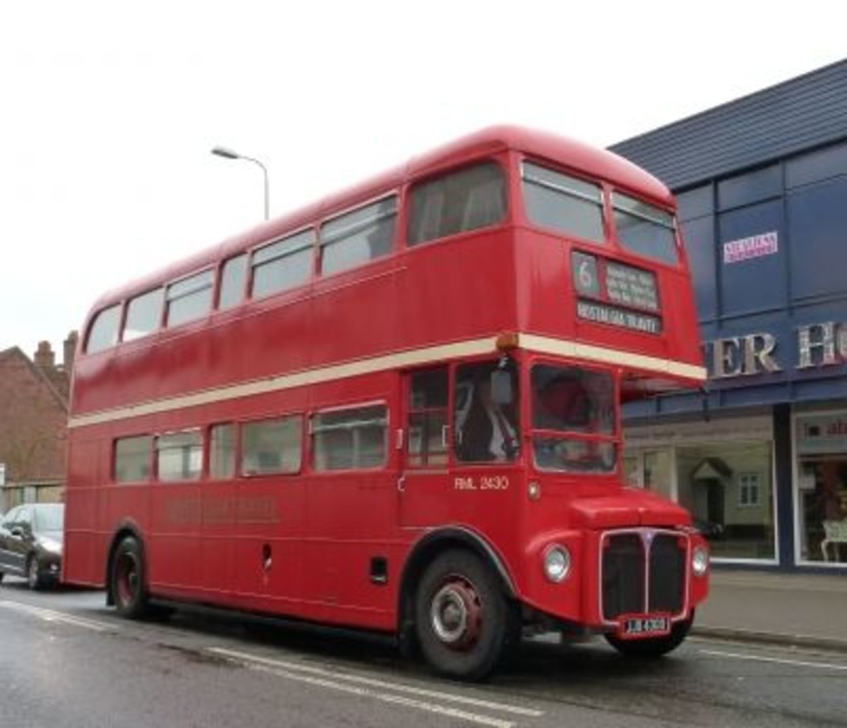 Routemaster Bus RML 2430 JJD 430D passing through  Abingdon on a  Rainy Day