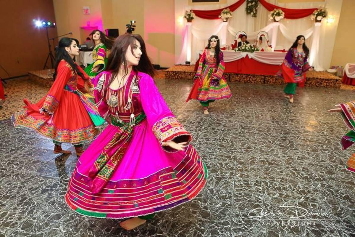 Girls in Afghani dresses dancing in afghan wedding