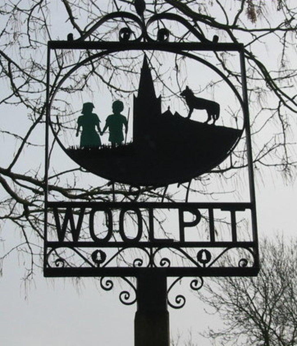 The village sign with the children depicted on it.