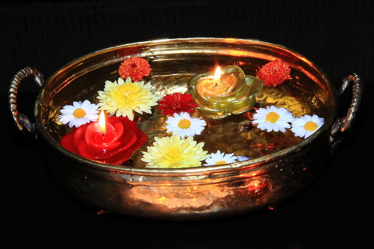 Floating Diyas and flowers in a vessel - A Diwali decoration