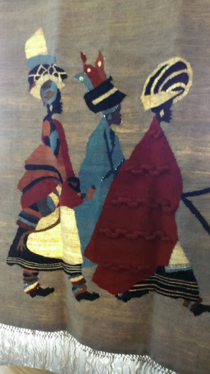 Woven wall hanging we bought in Lesotho with images of ama-Xhosa wearing skirts called imibhaco.