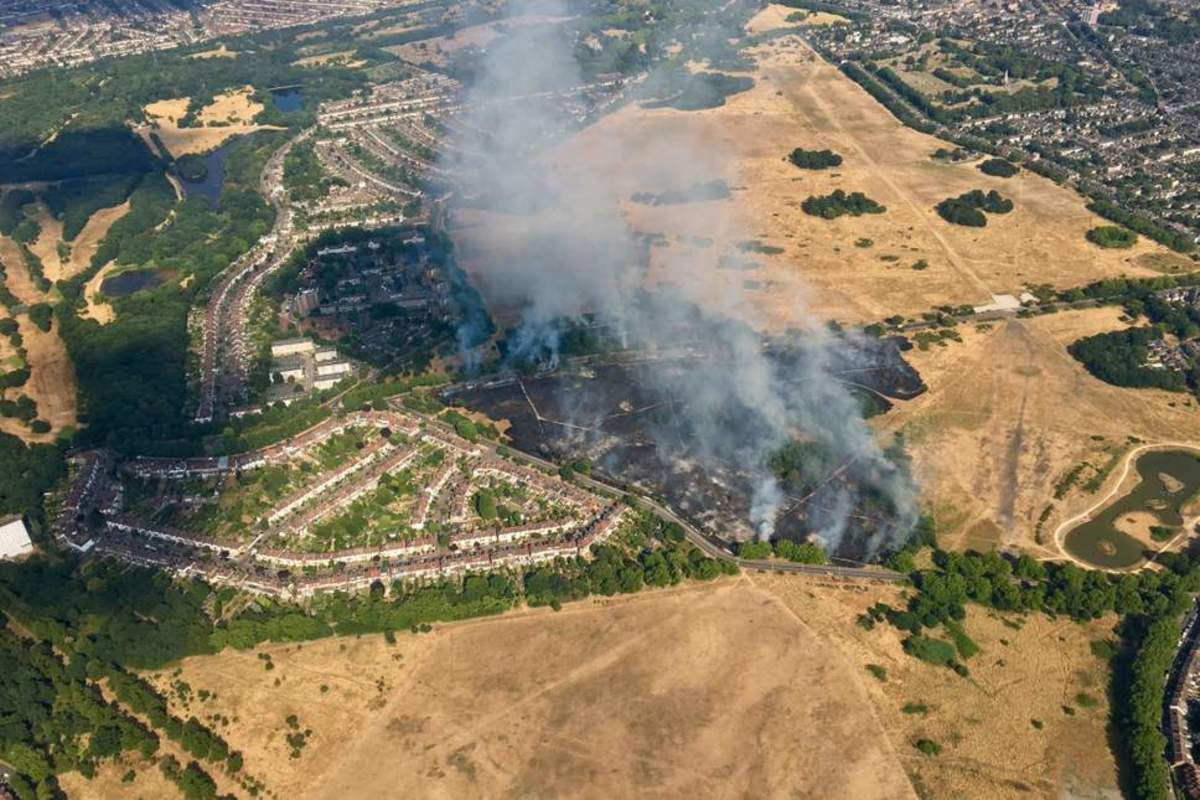 An aerial view looking eastward. The police were on the verge of evacuating the housing estate (left) before the fire was eventually controlled.