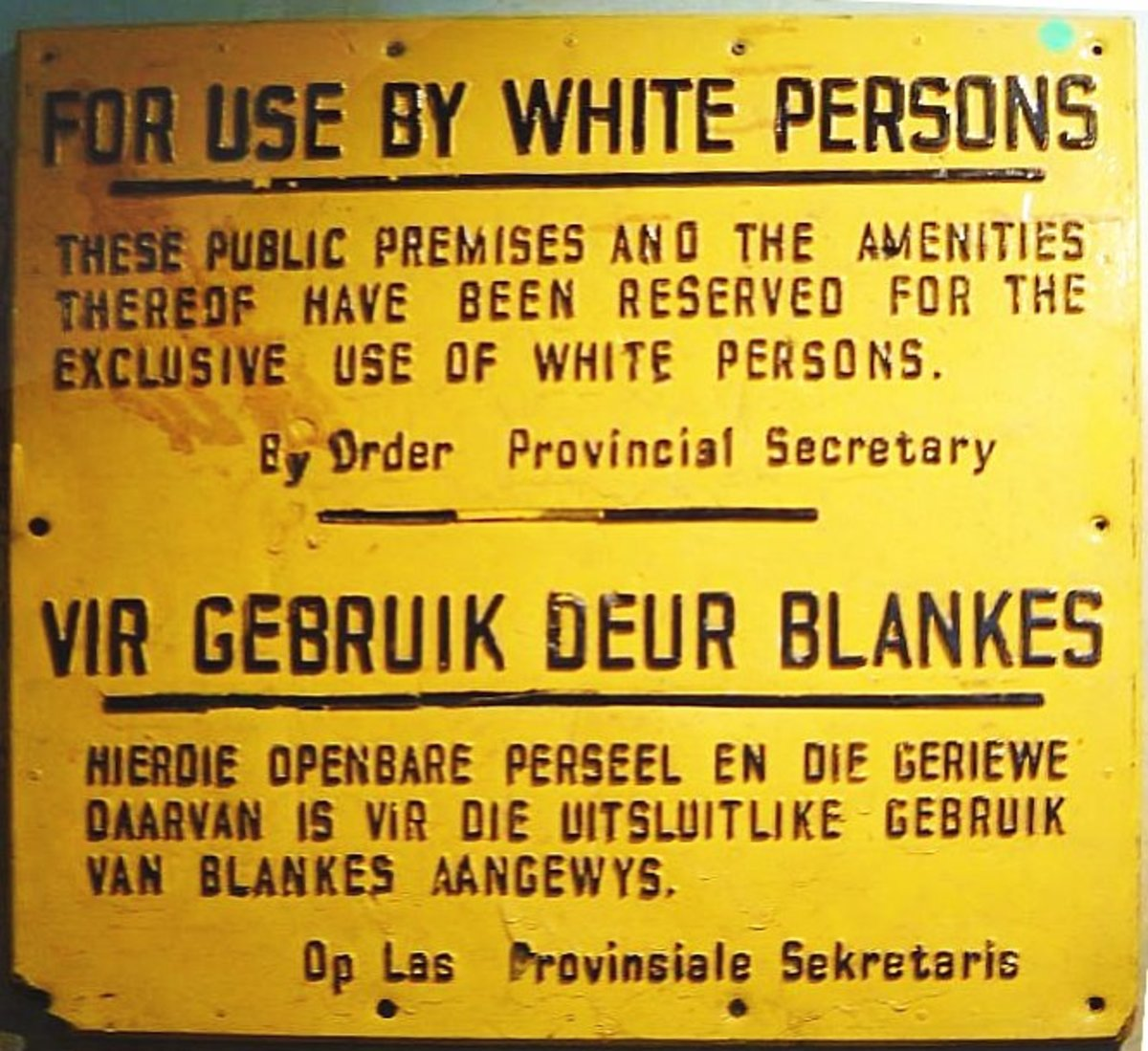 A notice indicating that a certain public premises solely for the use set by whites in South Africa
