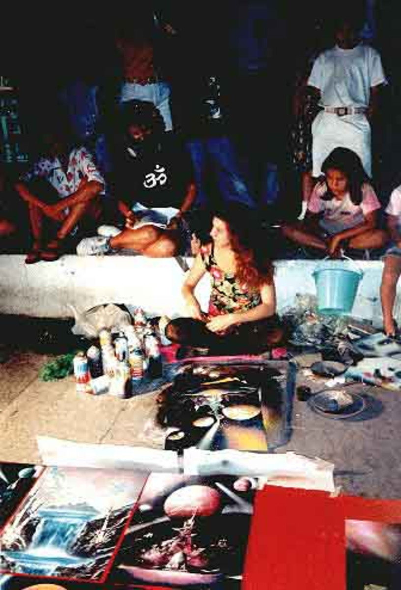 Alisa Amor painting on the Malecon of Puerto Vallarta, notice the student behind her taking careful note