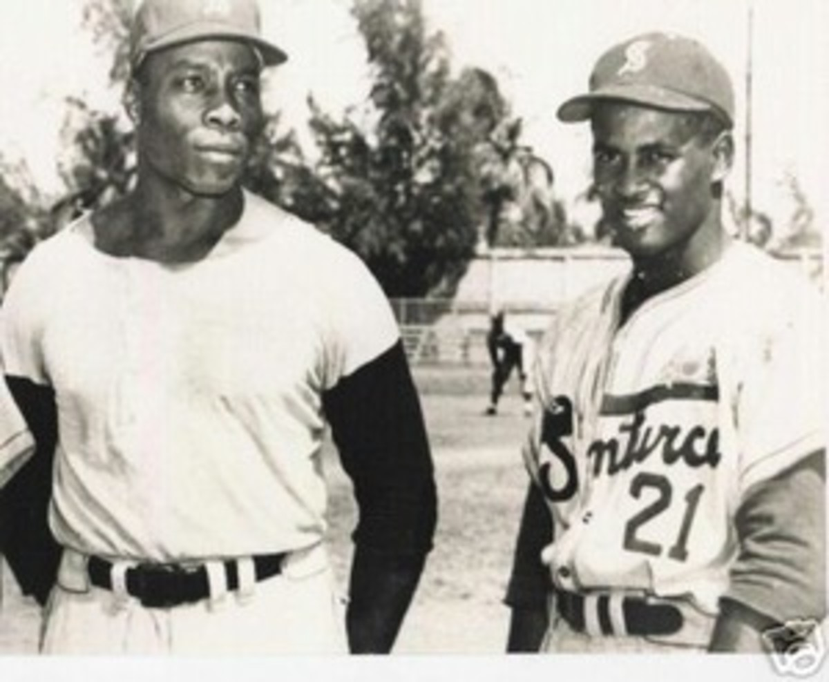 Bob Thurman and Roberto Clemente