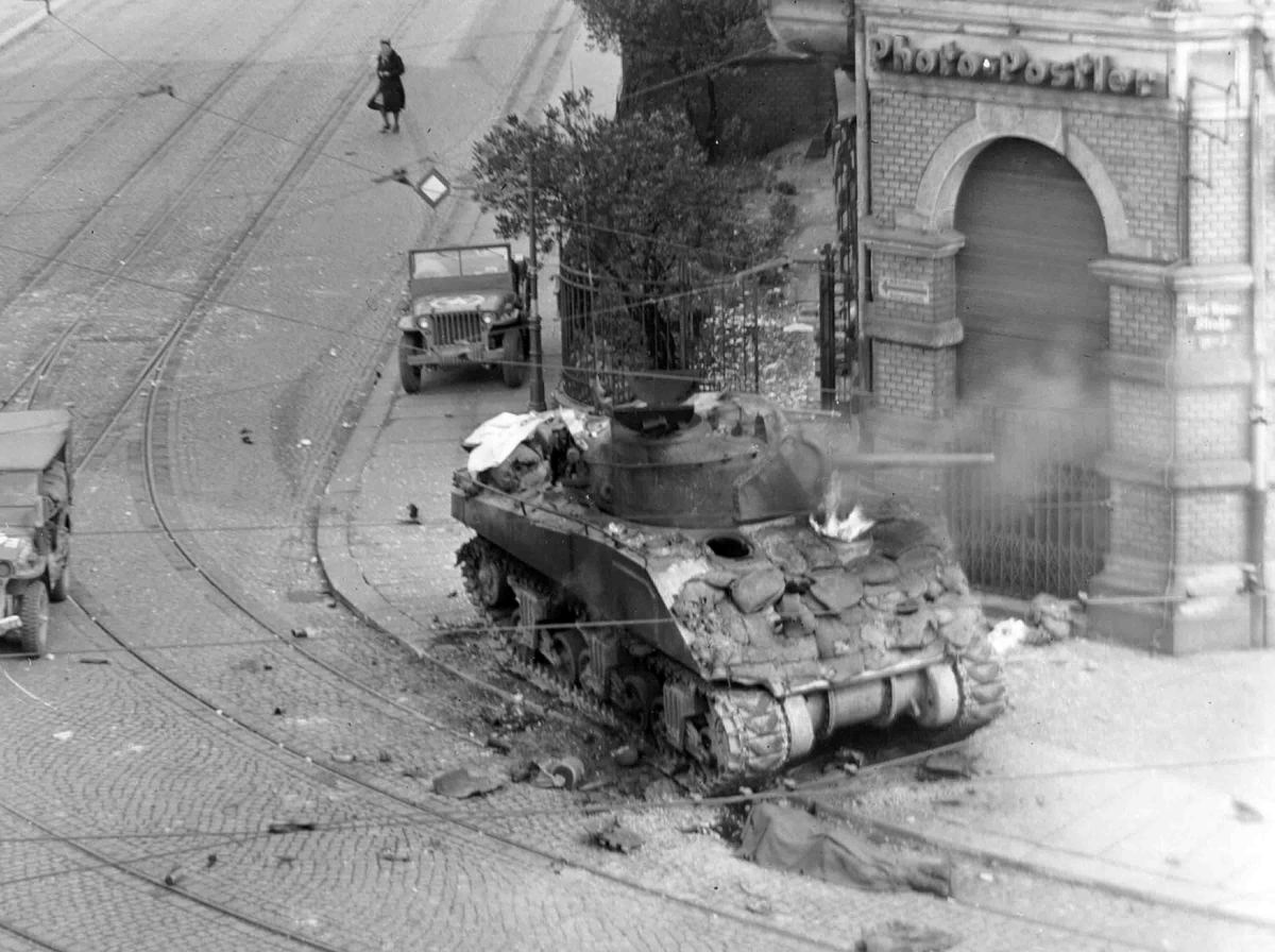 Sherman tank on fight in the streets of Aachen Germany 1945, they were so lightly armored most German anti-tank weapons easily pierced their armor. German hand held anti-tank weapons such as the Panzer-Faust proved deadly to Allied tank crews.