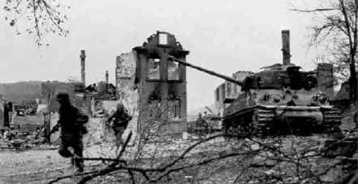 The American column had the new Sherman tanks with up to date long barrel 75mm cannons.