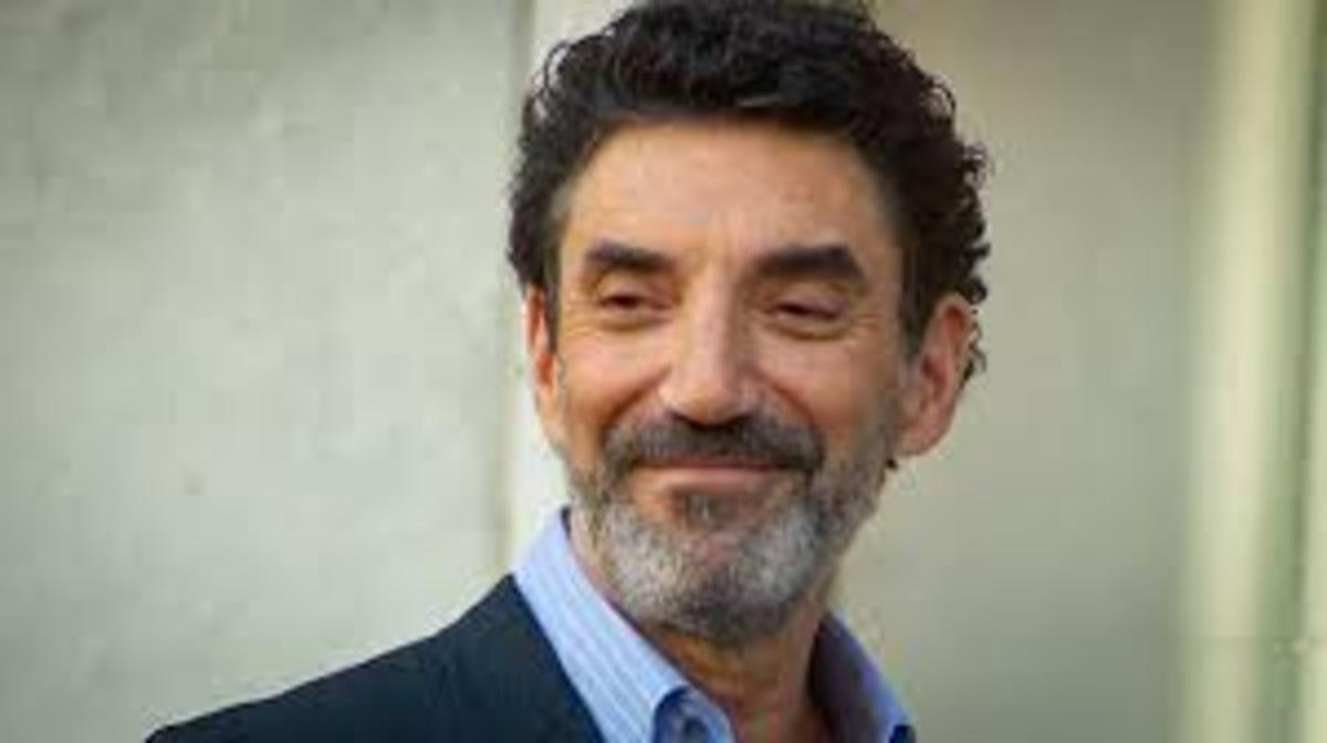 Chuck Lorre smiles a lot due to the many successful sitcoms he produces