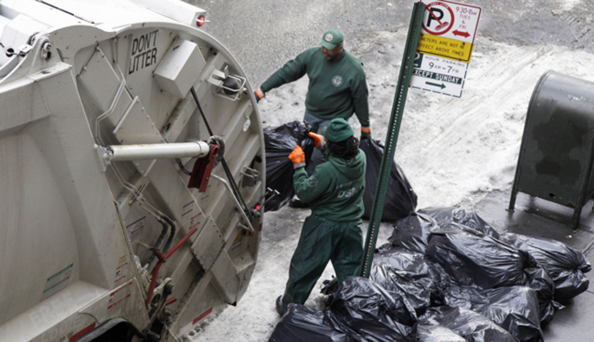 The garbage collectors collecting the garbage