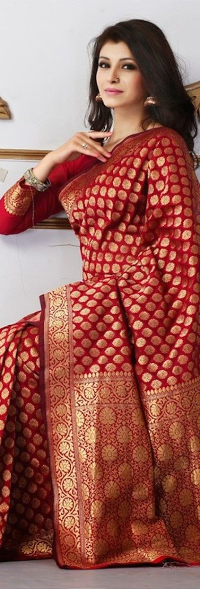 Gorgeous red katan saree with all over gold zari work