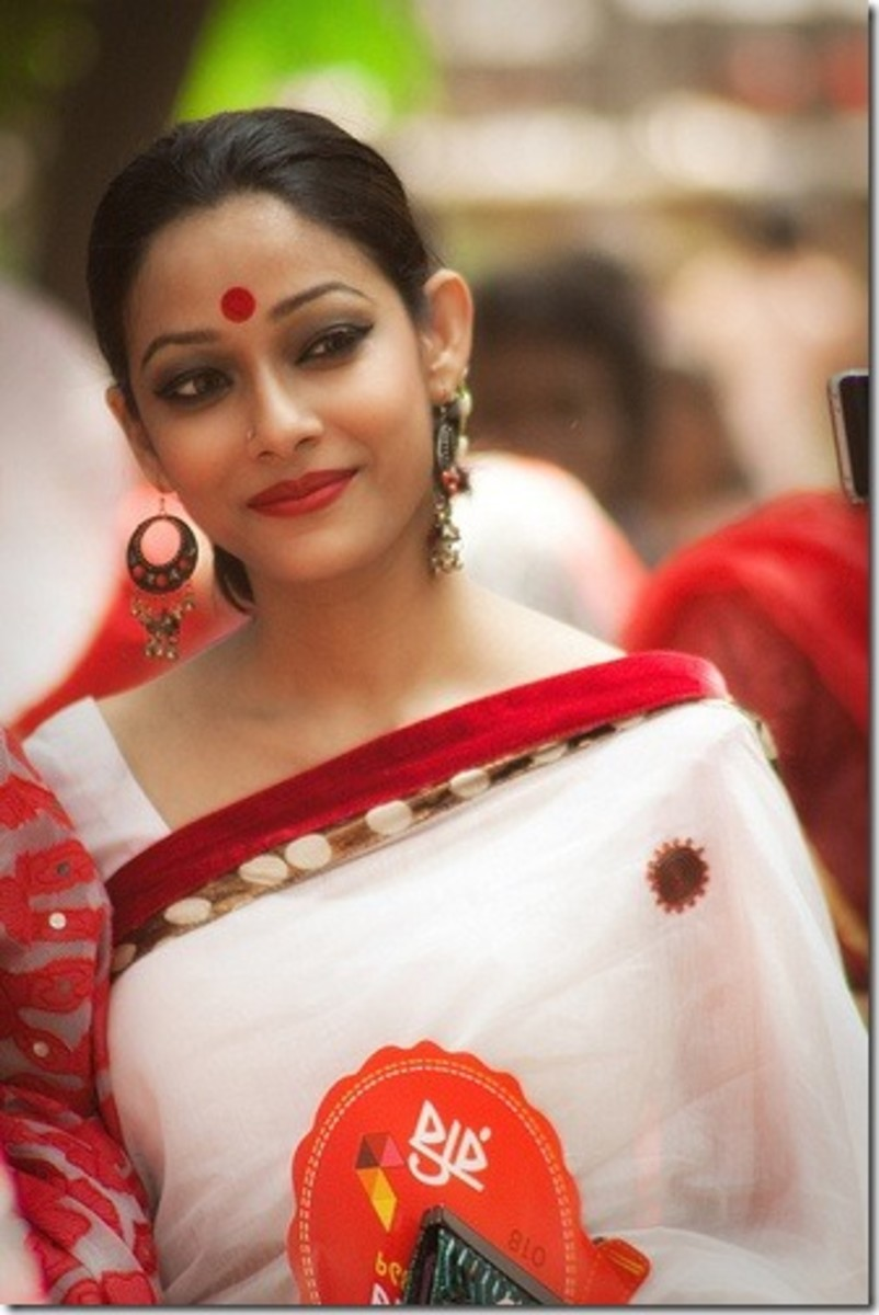 Bangladeshi woman in white saree with red border in bengali new year