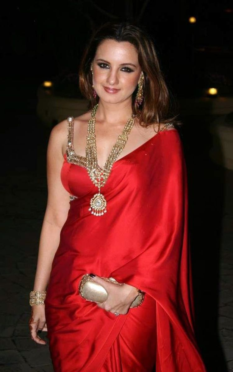 Red Satin Saree with sexy red sleeveless designer blouse