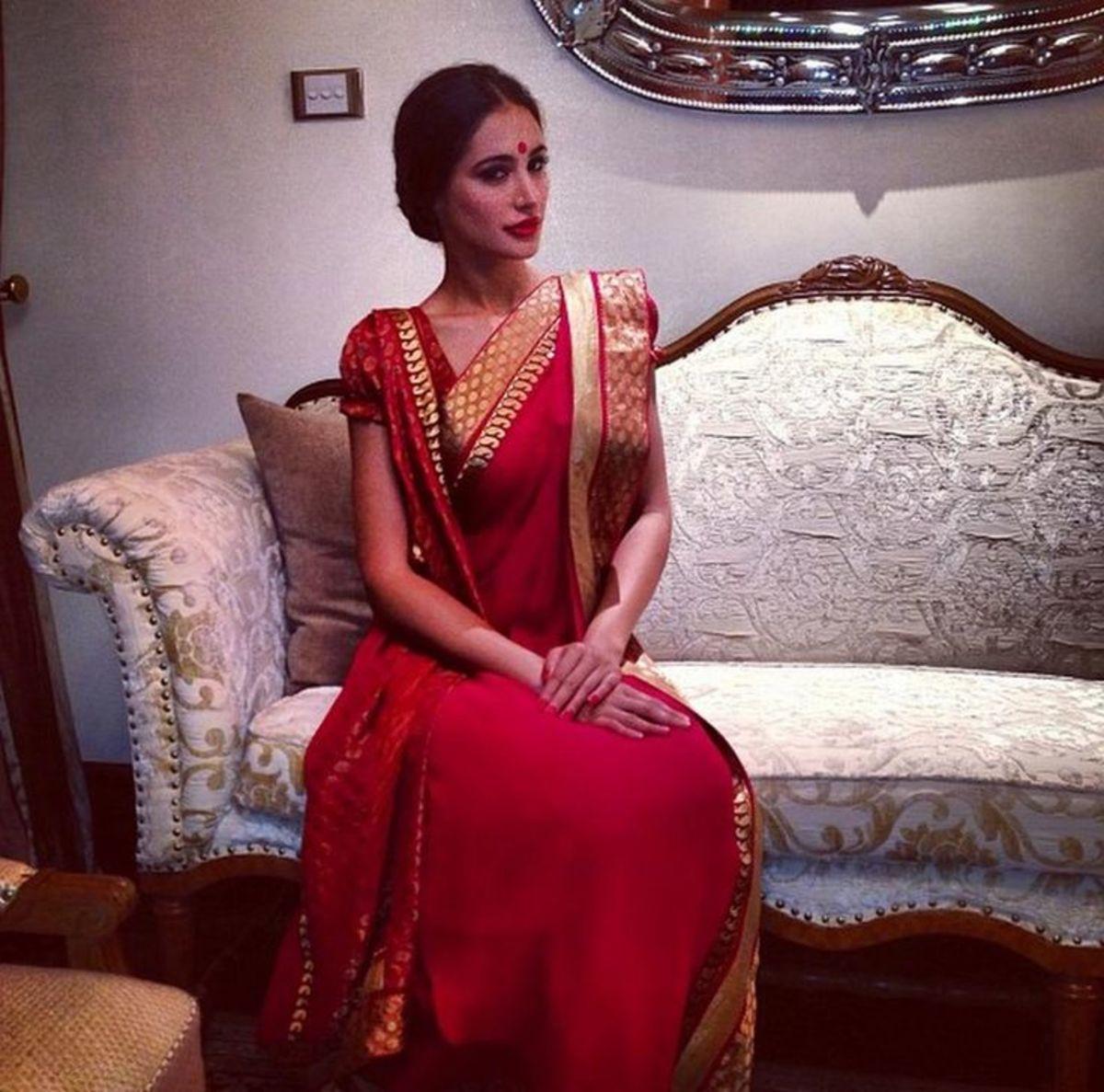 Red saree kolkata style drape