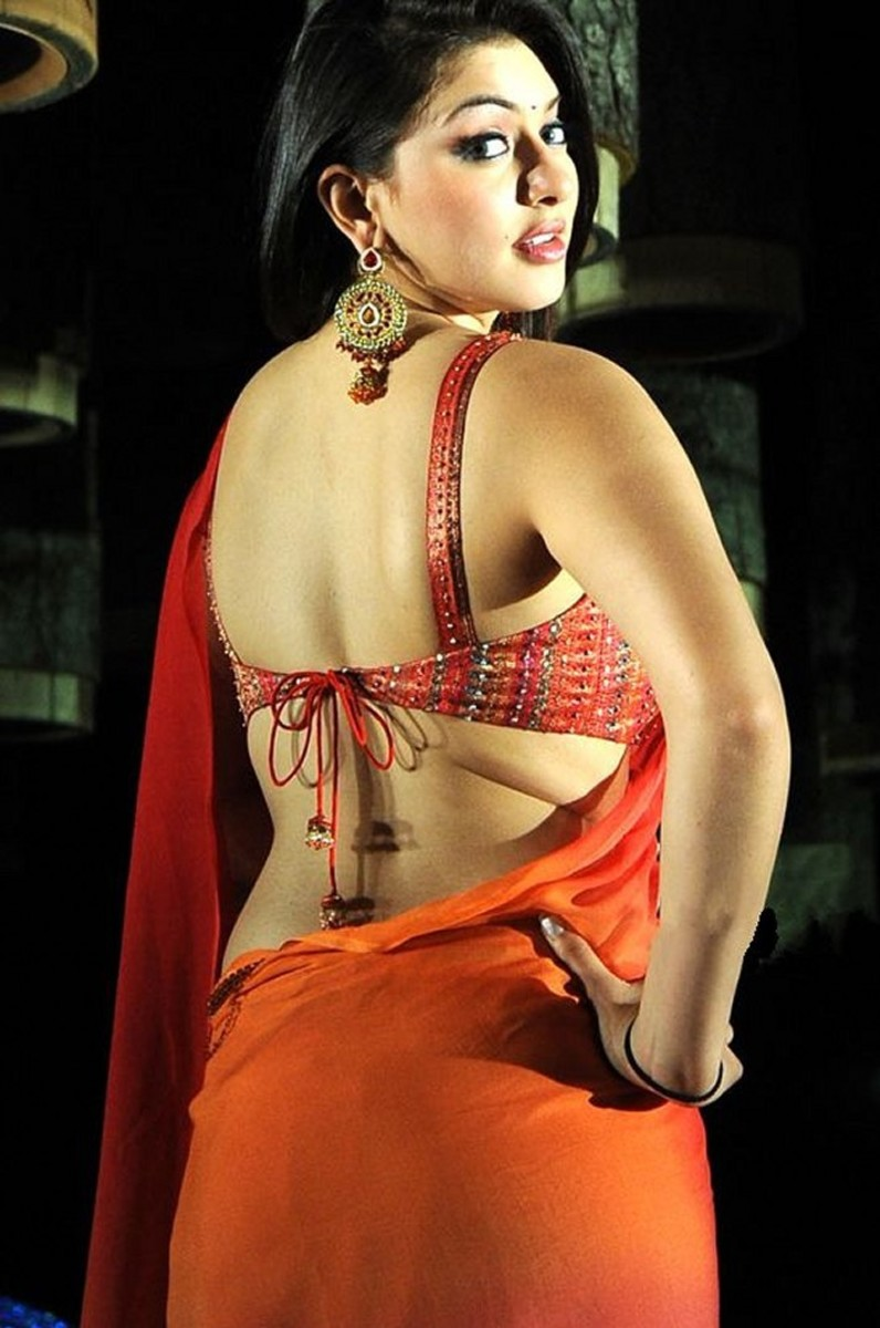 Revealing the flab in skimpy saree blouse looks downright tacky