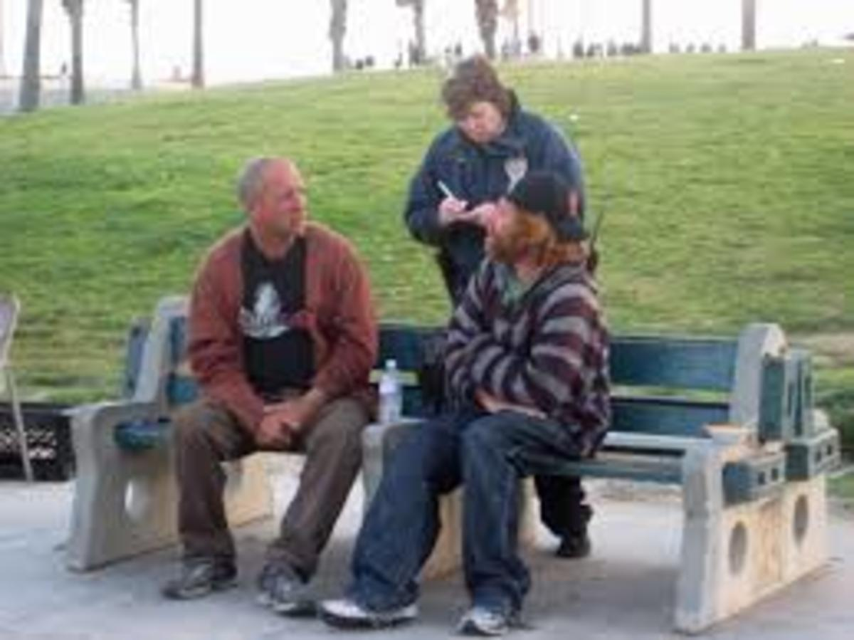 These citizens sitting on a park bench makes them just talking.