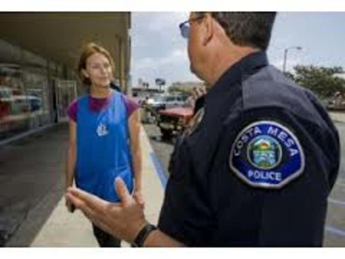 Police officer tries to find out if this girl is loitering or loafig.