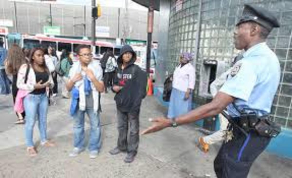 Police officer talks to would-be loiterers.