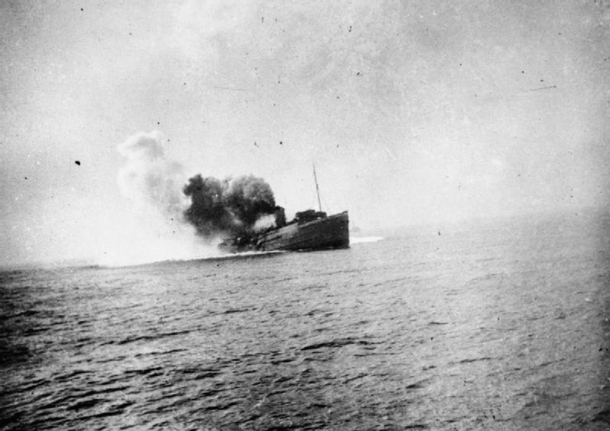 The Isle of Man steam ferry SS Mona's Queen sinking after striking a mine off Dunkirk, 29 May 1940.