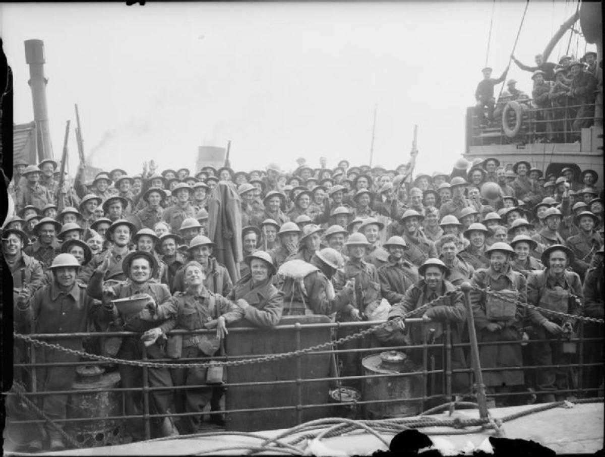 Cheerful British troops crowd the deck of a Royal Navy destroyer at Dover, 31 May 1940.
